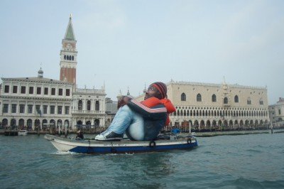 Inflatable Refugee | A giant refugee from the canals of Venezia and into the world