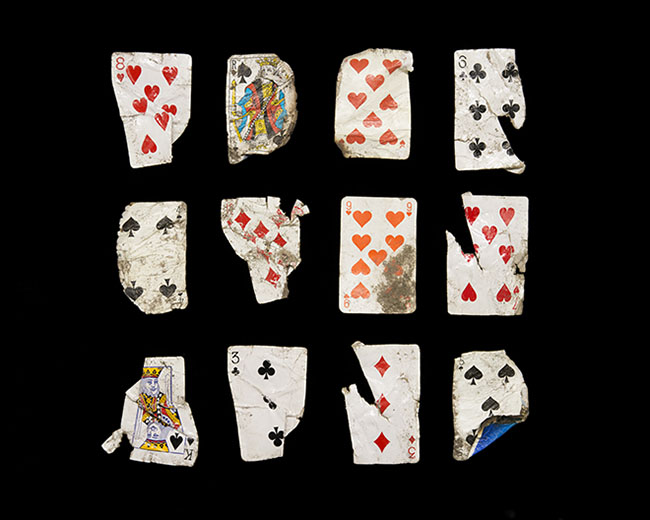 griot-mag-Dzhangal | The objects of Calais shot by Gideon Mendel-Twelve playing cards Collected 21 May 2016