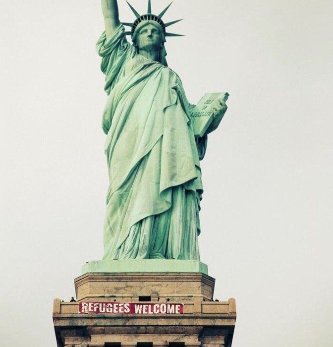 "griot-mag-refugees welcome-statue-liberty-nyc-edward-buchanan-- Sansovino6 says ""Resist!"" ""We are all Migrants!"" ""Wake up for freedom""-"